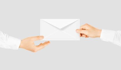 White blank envelope giving hand. Message send presentation.
