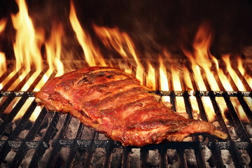Poster Grill / Barbecue Pork Baby Back Or Spareribs On BBQ Grill With Flames