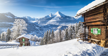 Winter wonderland in the Alps with traditional mountain chalets
