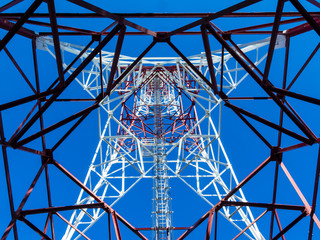 Communication tower over a blue sky