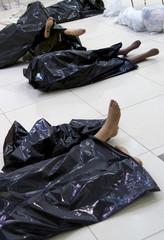 the broken dummies in black bags on a floor