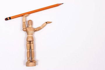 Mannequin with yellow pencil. Isolated on white background.