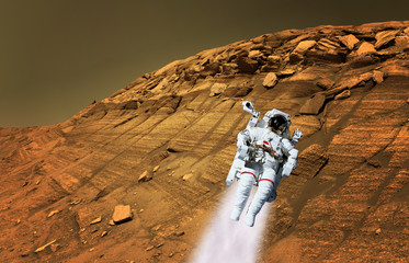 Astronaut spaceman suit planet Mars jet pack jetpack space landscape. Elements of this image furnished by NASA.
