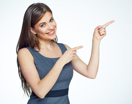 Smiling business woman pointing finger on copy space