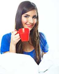 Smiling woman hold red coffee cup.