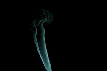 Blue smoke isolated on dark background