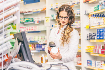 Pharmacist scanning price
