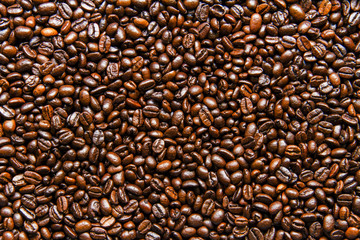 Roasted coffee beans background texture.
