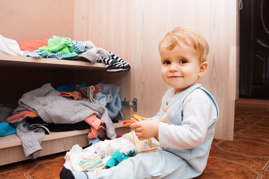 child playing with clothes
