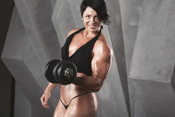 Woman bodybuilder training.