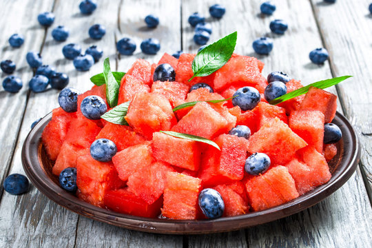 Watermelon Mint Summer Salad with blueberries, selective focus