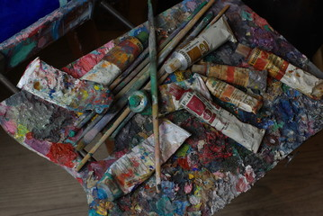 Palette with paint tubes and brusher