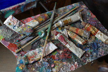 Painting palette with paint tubes and brusher