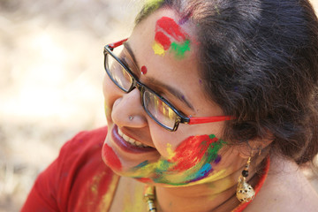 Very beautiful woman is enjoying Holi festival in India.