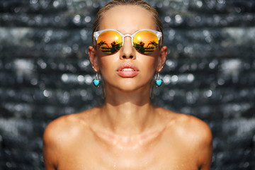 Fashion portrait of stylish naked woman in sunglasses - close up