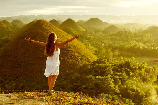 woman doing yoga in The Chocolate Hills. Bohol, Philippines