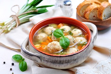 Vegetable soup with fish balls and wild garlic