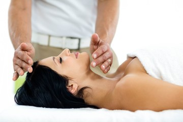 Pregnant woman receiving a spa treatment from masseur