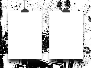 Close-up of two hanged paper sheets with clips on black and white ink splotchy background