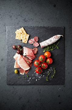 Mediterranean antipasto on a black slate