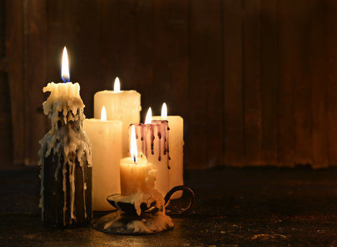 Group of candles burning in the darkness and copy space