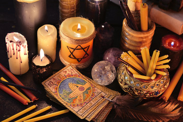 Magic objects and the tarot cards in candle light.