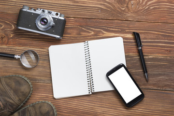 Travel, vacation concept. Camera and supplies on office wooden desk table. Top view with copy space for text