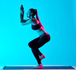 woman yoga exercices Garudasana eagle pose