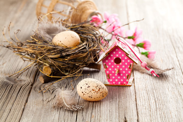 easter decoration on wooden background with color egg and with b