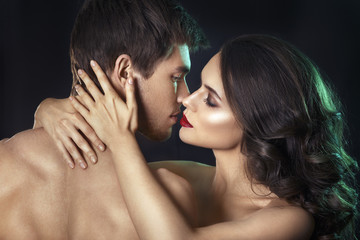 Kissing couple portrait.Sexy beauty couple.Portrait of happy loving couple.Pure passion.Sensual brunette woman in underwear with young lover, passionate couple foreplay closeup
