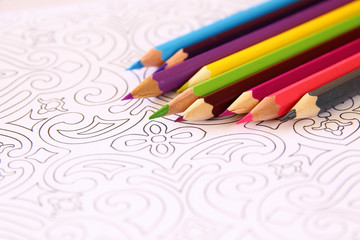 adult coloring book trend, for stress relief. top view. selective focus