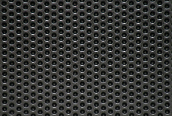 Photo of a natural perforated metal surface