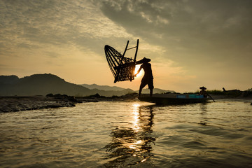 Two fishermen fishing on Mekong River, Laos
