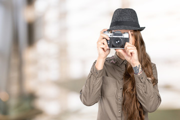 Young woman holding an old vintage camera