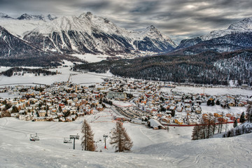 Scenic view of snow covered town against mountain range