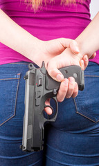 The back of a woman with a pistol in her hand