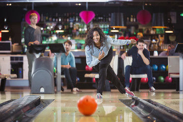 young black woman plays bowling