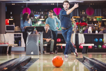 Group of friends playing in bowling alley