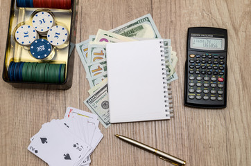 casino chips in suitcase with us money, cards, notepad