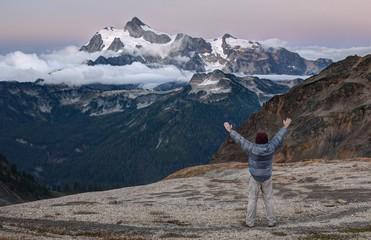Man standing with arms raised, Mount Shuksan, Washington, America, USA