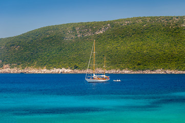 Sailing yacht at anchor in the beautiful Adriatic sea bay