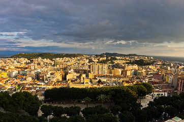 Panoramic view of Cagliari downtown at sunset in Sardinia, Italy