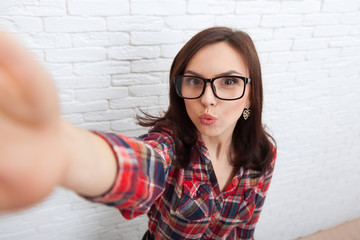 Young Beautiful Girl Taking Selfie Picture With Duck Face Lips Smart Phone Photo Camera