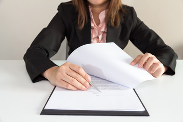 Woman pointing a place where should sign the contract