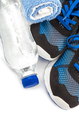 Sport shoes, towels and water bottle.