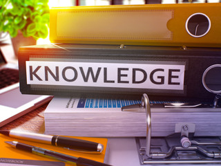 Black Office Folder with Inscription Knowledge on Office Desktop with Office Supplies and Modern Laptop. Knowledge Business Concept on Blurred Background. Knowledge - Toned Image. 3D.