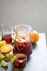 Woman Preparing Homemade Sangria - Wine with Lemonade