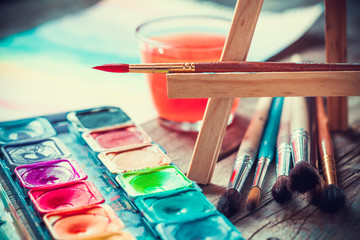 Set of watercolor paints and paintrushes for painting closeup.