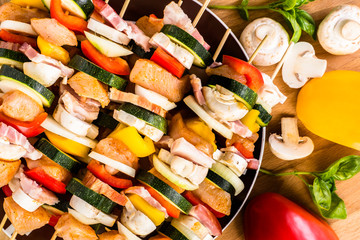 Shish kebab with chicken, becon and vegetables prepared for grill