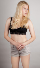 Young Woman in Lacy Crop Top and Shorts